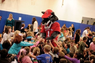 Wolfie entertains a crowd of excited students