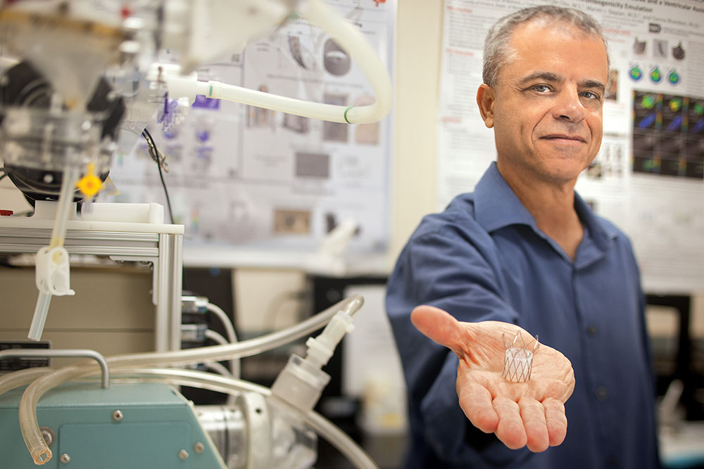 Danny Bluestein holds a transcatheter aortic valve replacement device, which acts like a natural heart valve.