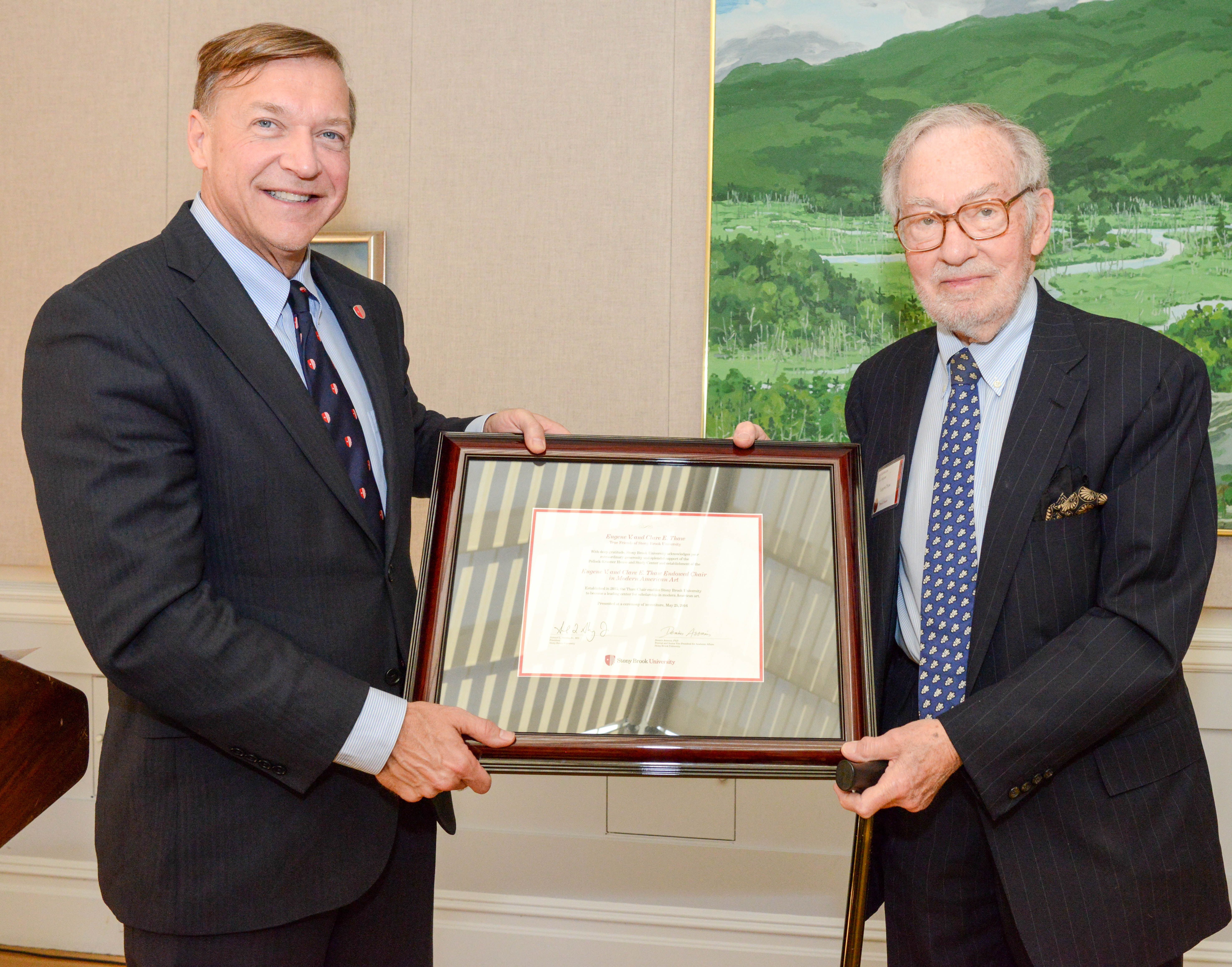 Stony Brook University President Samuel L. Stanley Jr. presents Eugene Thaw, esteemed art dealer and trusted friend and adviser to Lee Krasner, with a declaration honoring his generosity and support of the Pollock-Krasner House and Study Center and the establishment of the Eugene V. and Clare E. Thaw Endowed Chair in Modern American Art.
