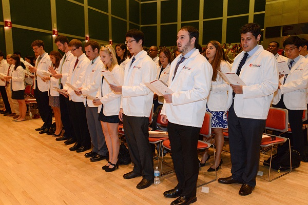 The Class of 2019 takes the Hippocratic Oath for the first time at the White Coat Ceremony.
