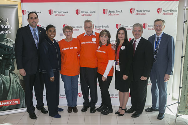 (left to right): New York State Assemblyman Chad Lupinacci ; Brookhaven Town Councilwoman Valerie Cartright ; Cathy Ryan, mother of donor; Tom Callaghan , Kidney Transplant Recipient; Sandra Garcia, Kidney Transplant Recipient; Dawn Francisquini RN BSN, Transplant Senior Specialist, Stony Brook University Department of Transplants; Suffolk County Executive Steve Bellone; and Kenneth Kaushansky, MD, MACP, Senior Vice President, Health Sciences, and Dean, Stony Brook University School of Medicine.