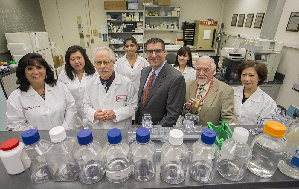 The research team evaluating compounds to potentially treat inflammatory diseases such are periodontitis assemble in their School of Dental Medicine laboratory. From left: Dr. Maria Ryan, Dr. Ying Gu, Dr. Lorne Golub, Joseph Scaduto, Dr. Francis Johnson, and Dr. Hsi-Ming Lee. In back, from left: Veena Raja and Jie Deng.