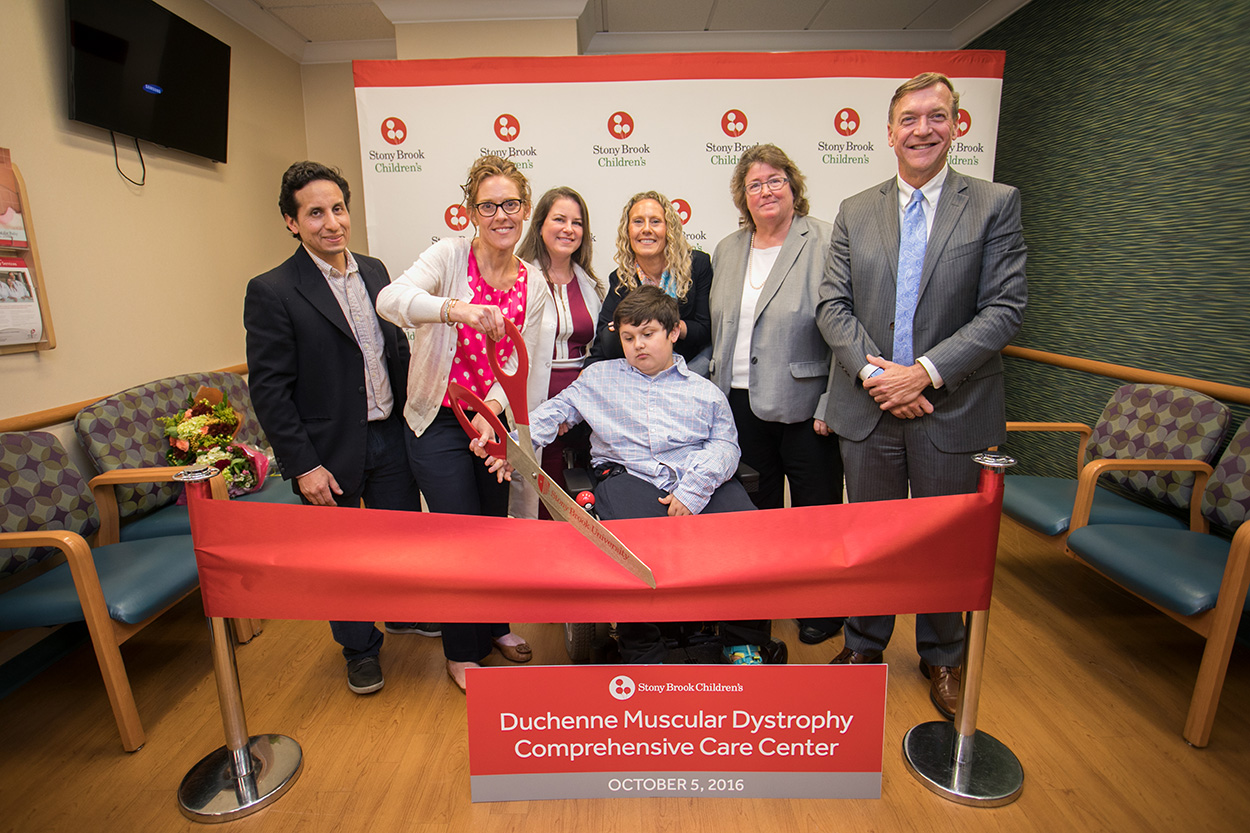 (Standing: Left to Right) Rich Romero, Board Member for Hope For Javier and Javier's father, Jennifer Portnoy, Co-Founder of Hope for Javier, Javier's mother, Susan Manganaro, MD, Medical Director, Duchenne Muscular Dystrophy Comprehensive Care Center, Assistant Professor, Neurology and Pediatrics, Stony Brook Children's Hospital, Stasia Portnoy, Board Member for Hope for Javier and Javier's aunt, Margaret McGovern, MD, PhD, Professor and Chair, Department of Pediatrics, Stony Brook University School of Medicine, Physician-In-Chief, Stony Brook Children's Hospital and Samuel L. Stanley, Jr., MD, President, Stony Brook University (Seated) Javier Romero, Duchenne Muscular Dystrophy patient, Namesake of Hope For Javier