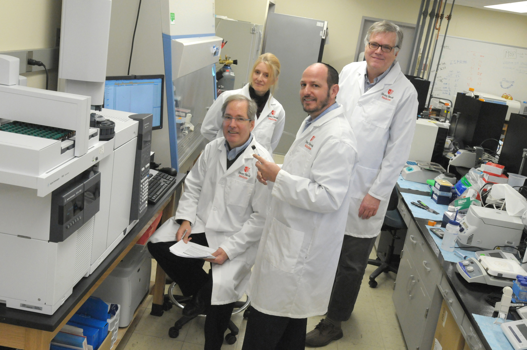 Stony Brook Cancer Center research pathologists, pictured in front, from left: John Haley, PhD, and Geoffrey Girnun, PhD. In back: Patricia Thompson, PhD, and Scott Powers, PhD.