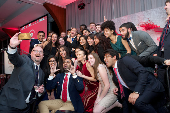 Stony Brook CIO Cole Camplese grabs a selfie with President Stanley and students.