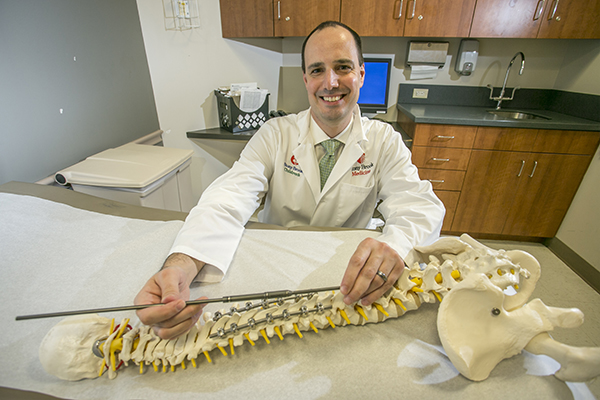 James Barsi, M.D. Assistant Professor of Orthopaedic Surgery, Stony Brook Medicine, showing the MAGEC rod device for scoliosis