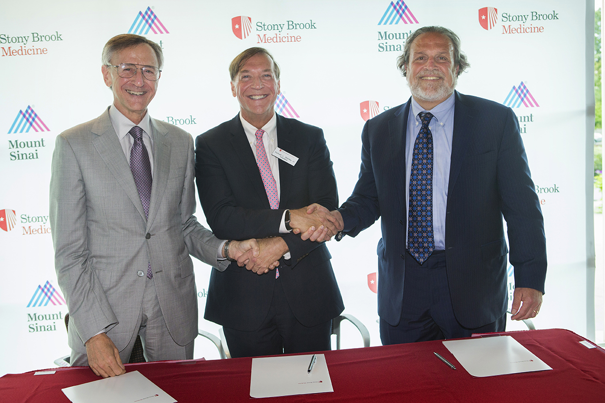 Stony Brook University President Samuel L. Stanley Jr., MD, center, shakes hands with Kenneth Kaushansky, MD, Senior VP, Health Sciences and Dean, Stony Brook University School of Medicine (left), and Dennis S. Charney, MD, the Anne and Joel Ehrenkranz Dean, Icahn School of Medicine at Mount Sinai, and President, Academic Affairs, Mount Sinai Health System (right) after signing the affiliation agreement.