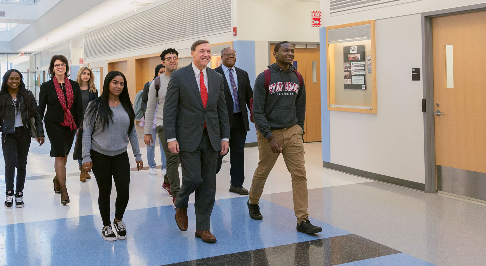 president stanley wakling with students