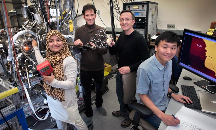 At Brookhaven Lab (left to right): Nusnin Akter, Anibal Boscoboinik, Dario Stacchiola, and Jianqiang Zhong study a two-dimensional zeolite catalyst model system within an ultra-high vacuum chamber, where they use X-ray photoelectron spectroscopy and scanning tunneling microscopy to characterize the model and examine its surface chemistry.