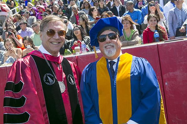 Stony Brook University President Samuel L. Stanley Jr., M.D and Grammy winning singer Billy Joel at Stony Brook University's 55th Annual Commencement