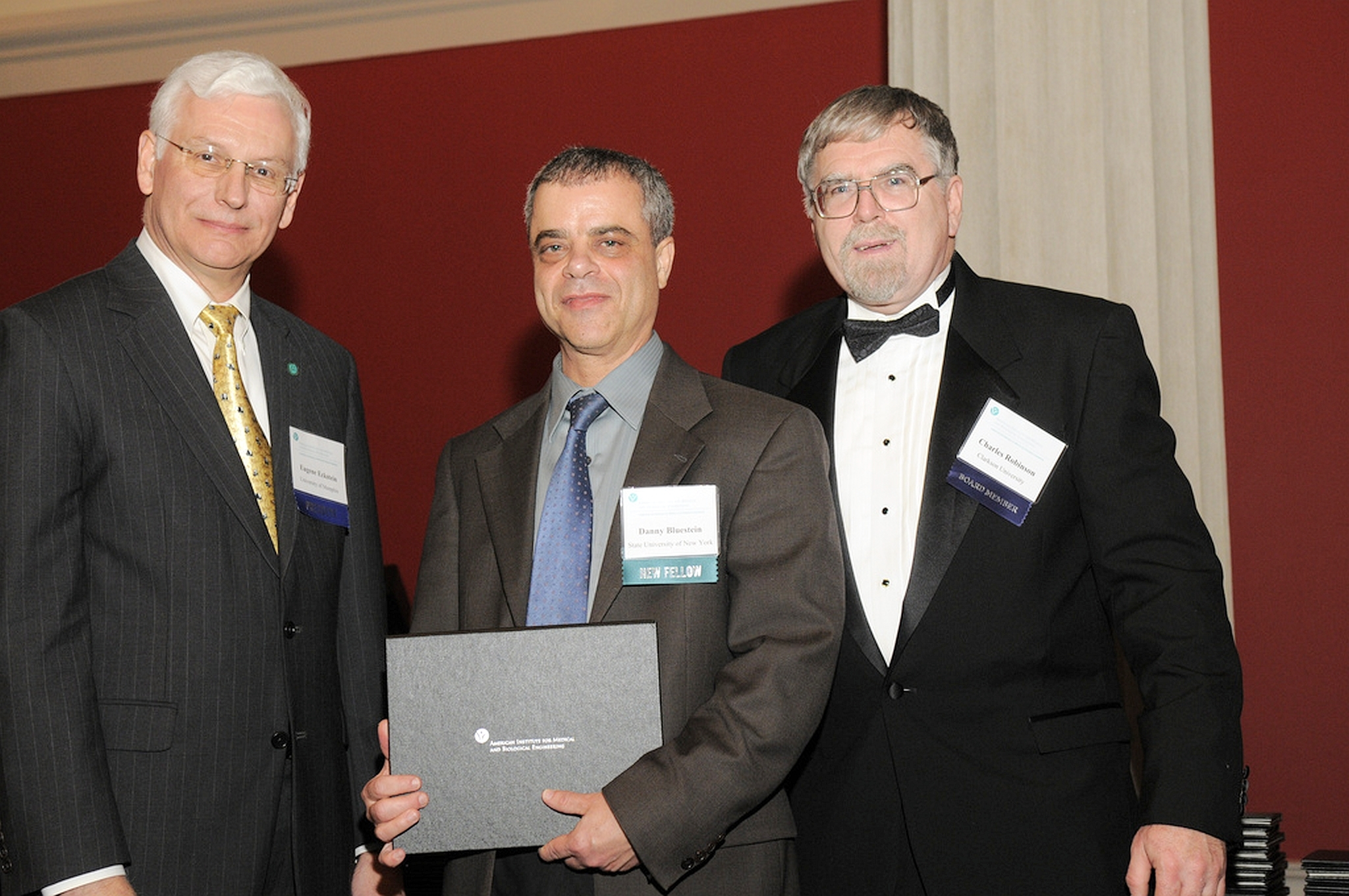 Danny Bluestein, standing between Professor Eugene Eckstein, AIMBE president (left) and Professor Charles J. Robinson, AIMBE vice president, at the AIMBE's College of Fellows awards ceremony.