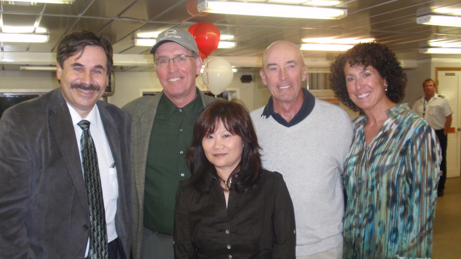 Dr. Schuster (left) is joined by (left to right) John Sutter, Gene Travers, Angela Travers and Susan Yang (front).