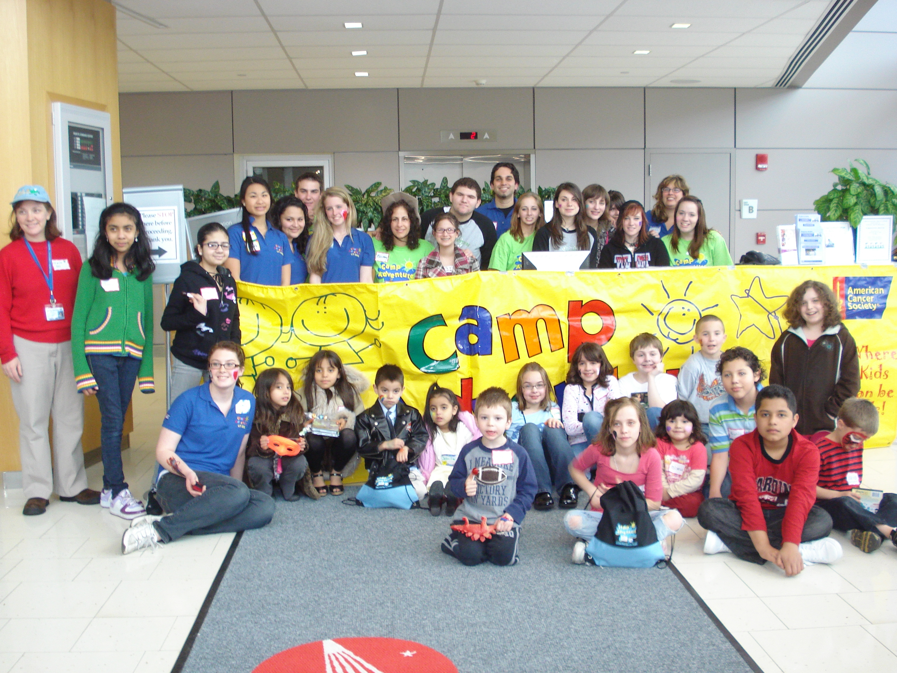 Some of the SBUMC pediatric cancer patients, their siblings, and SBUMC staff of Pediatric Hematology/Oncology gathered during A Day at Camp, a one-day preview of the American Cancer Society-sponsored Camp Adventure.