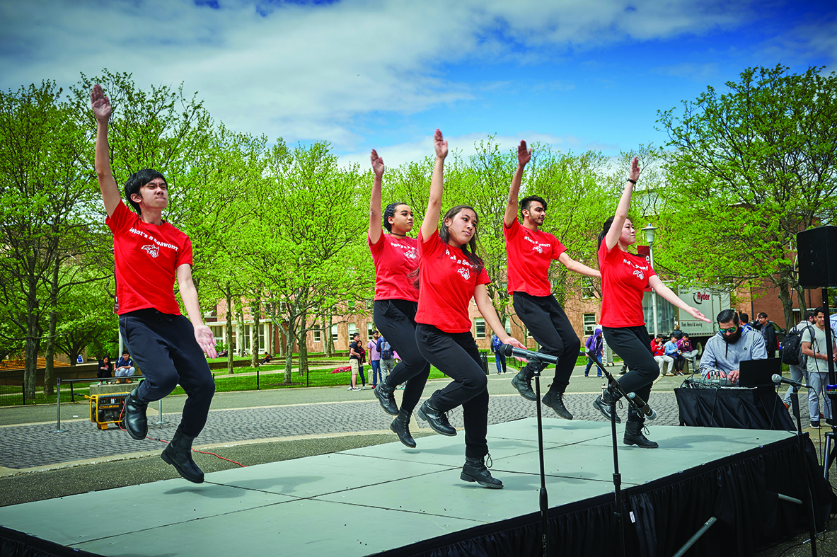 Stony Brook students perform on the Academic Mall.