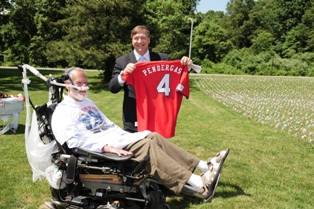 "As a surprise and special gift of appreciation for Christopher Pendergast, President Stanley presented a ""champion's jersey,"" a Stony Brook Seawolves baseball jersey with Pendergast's name and Lou Gehrig's number 4 to Christopher at Stony Brook's Ride for Life Ceremony."
