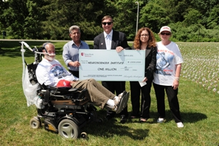 Christopher Pendergast and wife, Christine Pendergast (far right), presented Stony Brook University President Dr. Samuel L. Stanley Jr. (center), and Co-Directors of the Christopher Pendergast ALS Center of Excellence, from left, Drs. Rahman Pourmand and Nurcan Gursoy, with a $1 million check to support ALS clinical trials at Stony Brook.