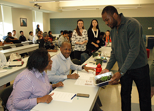 Kaydon Davis '17 shows prototype results to faculty judges during an in-class presentation.