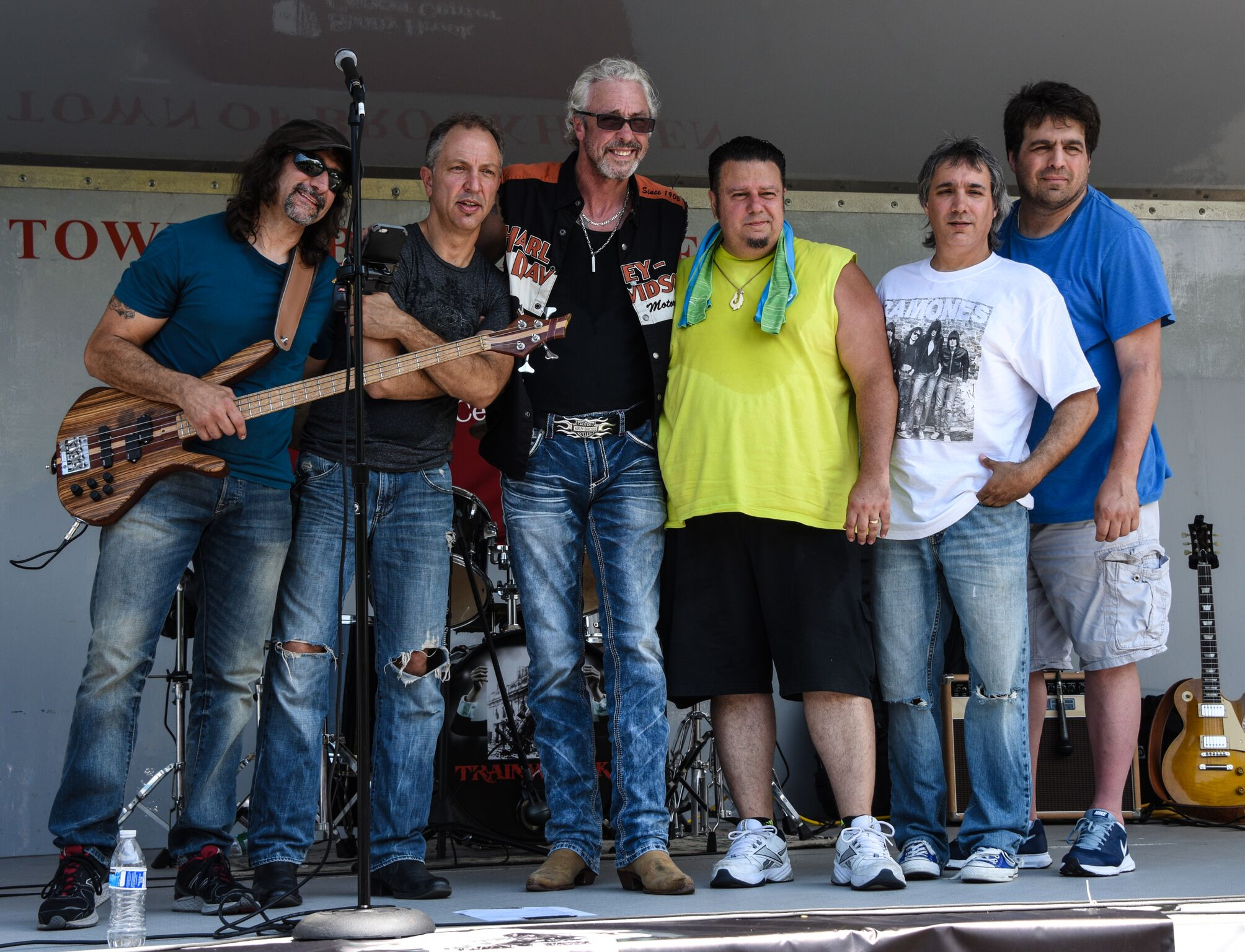 "102.3 FM WBAB Radio Host 'Fingers' (third from left) takes the stage with classic rock band, ""TRAINWRECK."" Photo credit: Mac Titmus"