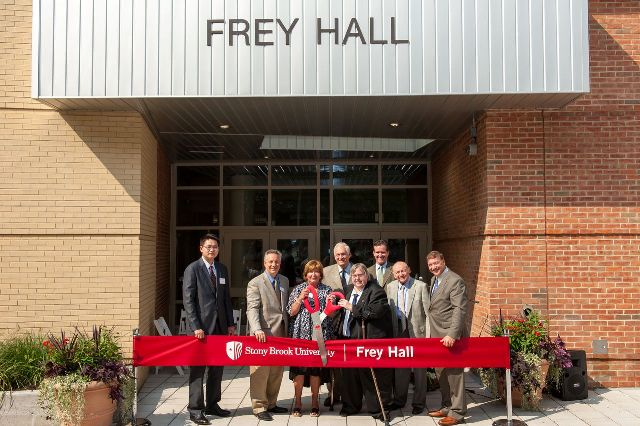 Freyhall ribbon cutting group 2 banner