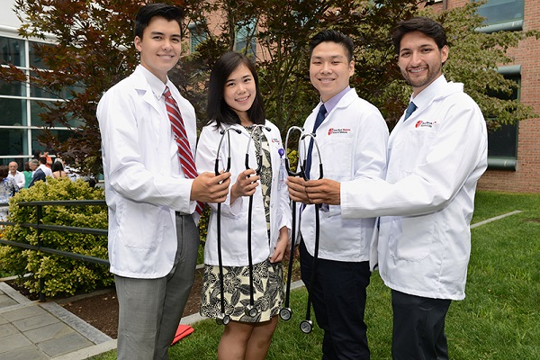 A group of new Stony Brook medical students display their first stethoscopes, donated by the School's Alumni Association.