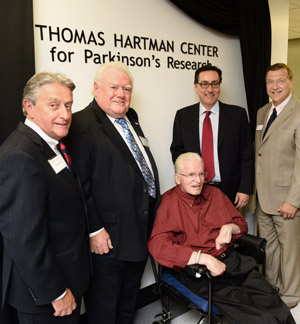 Pictured from left to right are Doug Manditch, Joe Collins, Father Tom Hartman, Ernie Canadeo and Stony Brook University President Samuel L. Stanley Jr., MD.