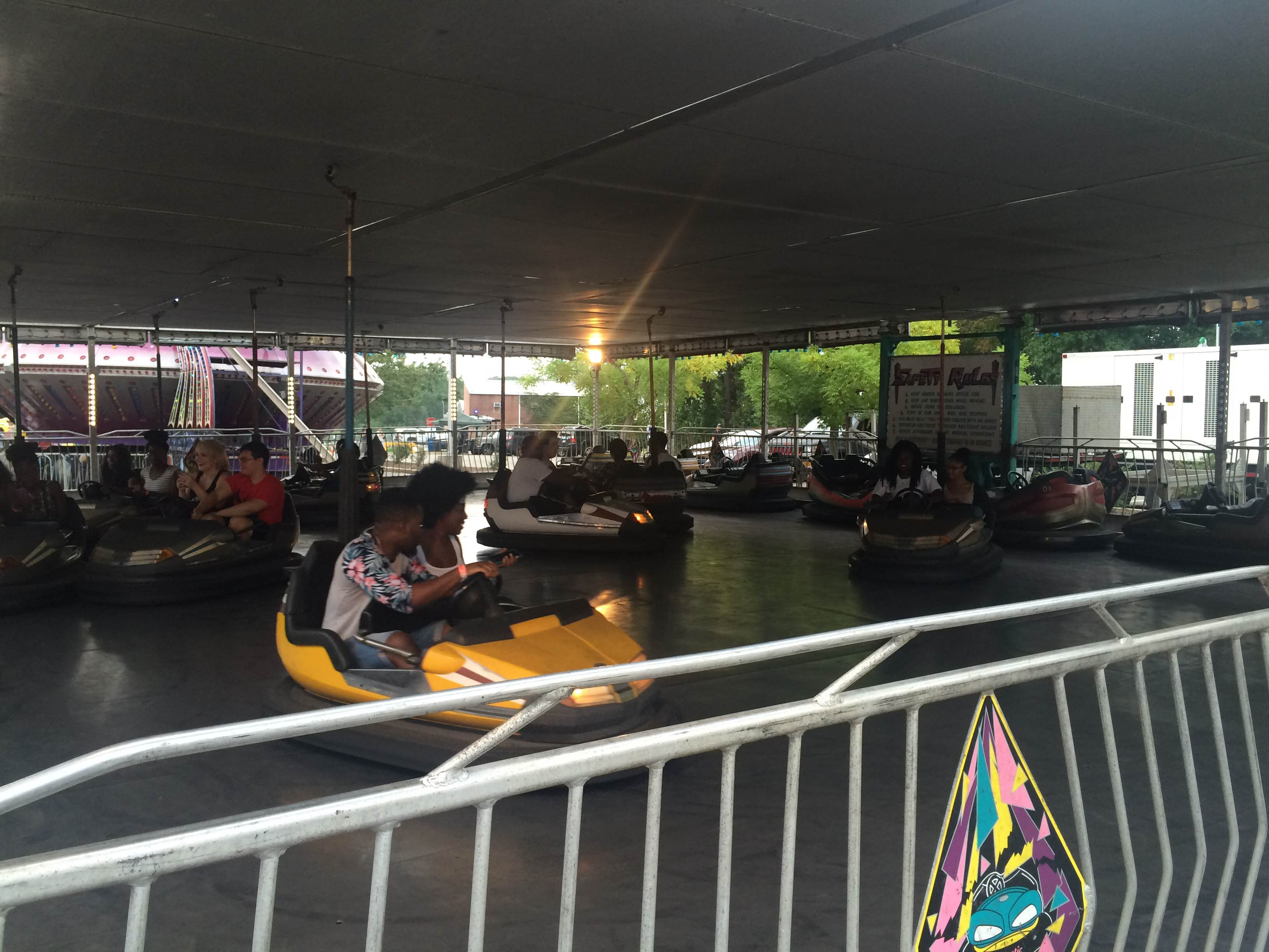 Students riding bumper cars at Wolfieland.