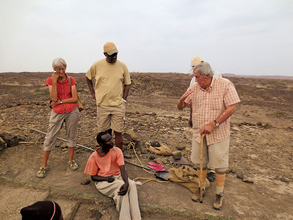 Richard and Meave Leakey discuss excavation strategy with members of the Koobi Fora Research Project team in East Turkana, 2014. Photo by Mike Hettwer
