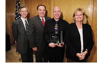 Douglas S. Katz, MD, FACR., '90, holds his 2012 Stony Brook University School of Medicine Distinguished Alumnus Award. With Dr. Douglas, from left: Kenneth Kaushansky, MD, MACP, Senior Vice President for the Health Sciences, and Dean, School of Medicine; Anthony Girardi, MD, FACS, '80 President, Stony Brook University School of Medicine Alumni Board; and Elaine S. Gould, MD, FACR, Professor of Clinical Radiology and Orthopedic Surgery.