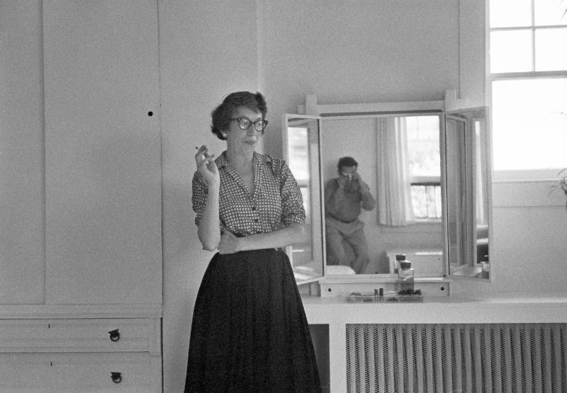 Lee Krasner in her bedroom, with Tony Vaccaro reflected in the mirror. © Tony Vaccaro Studio