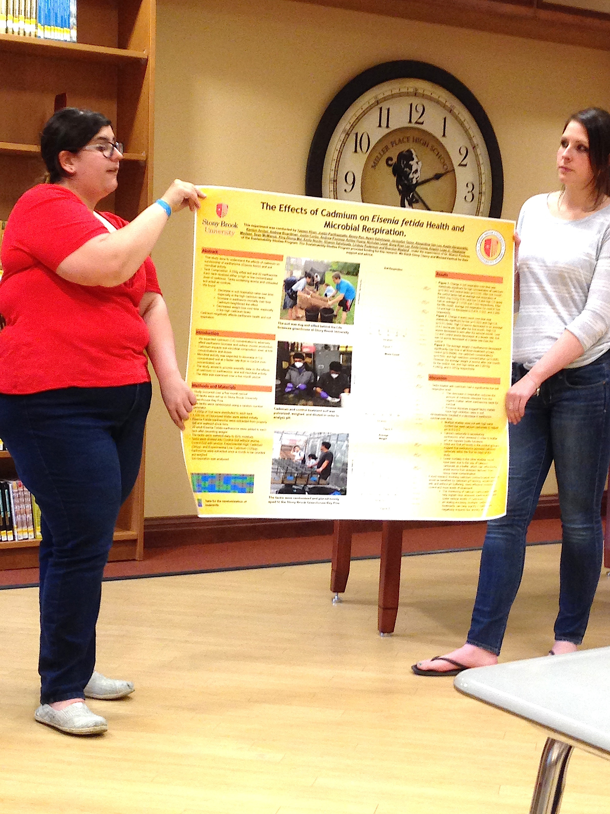 SBU Students Emily Nocito (L) and Jacky Taylor make their presentation on earthworms to the Miller Place Science Club. (Photo by Sharon Pochron)