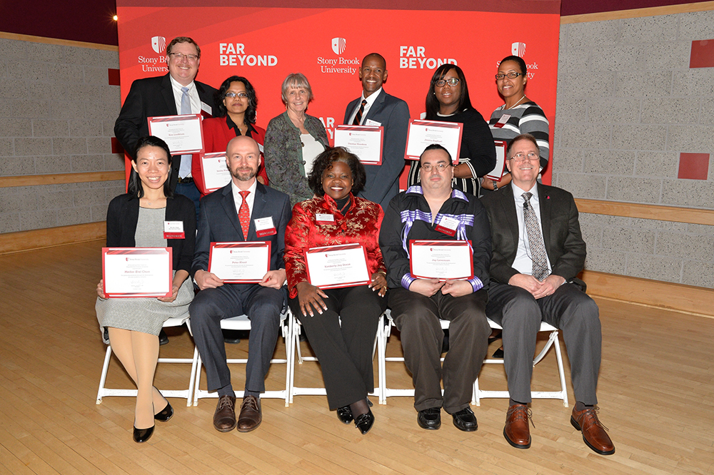 The Mini-Grant Award Recipients who were able to attend the annual dinner. Back row: Ken Lindblom, Smita Majumdar Das, Anne McElroy, Thomas Woodson, Jessica Raphael and Tricia Simons Figuero; front row: Meilin Ete Chan, Peter Khost, Kimberly Joy Dixon, Jay Levenson and Provost Taber.
