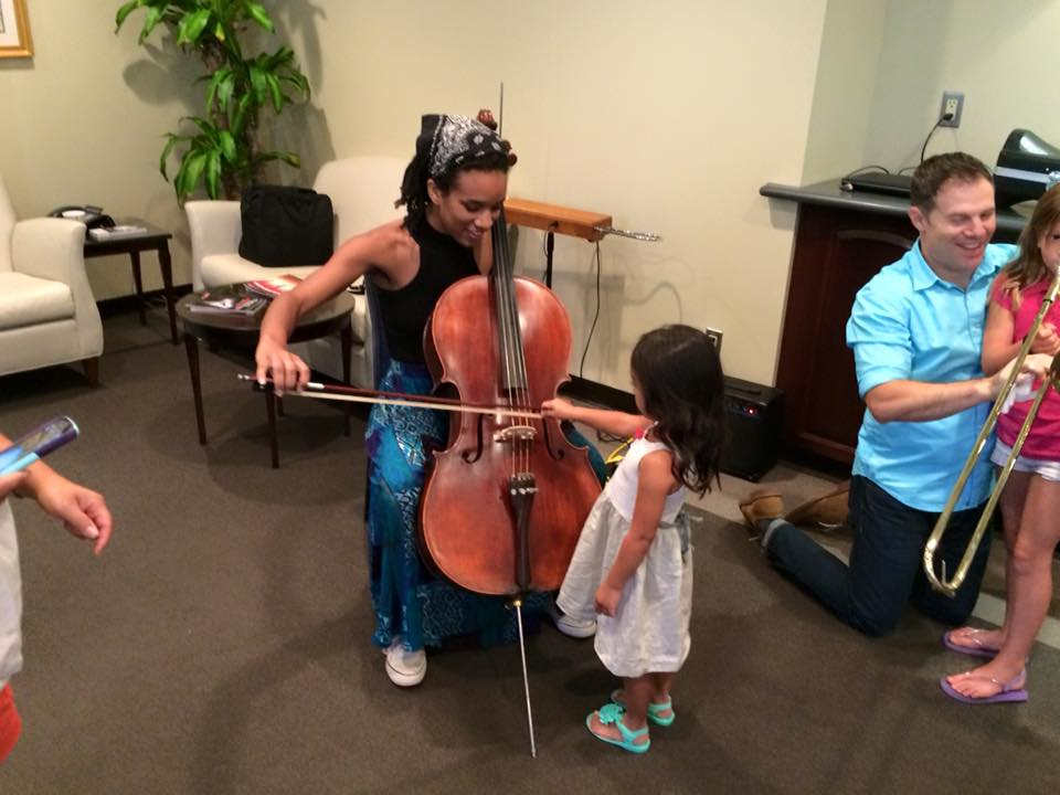 The Instrument Petting Zoo from Staller Center introduces children to musical instruments (photo by Paul Newland).