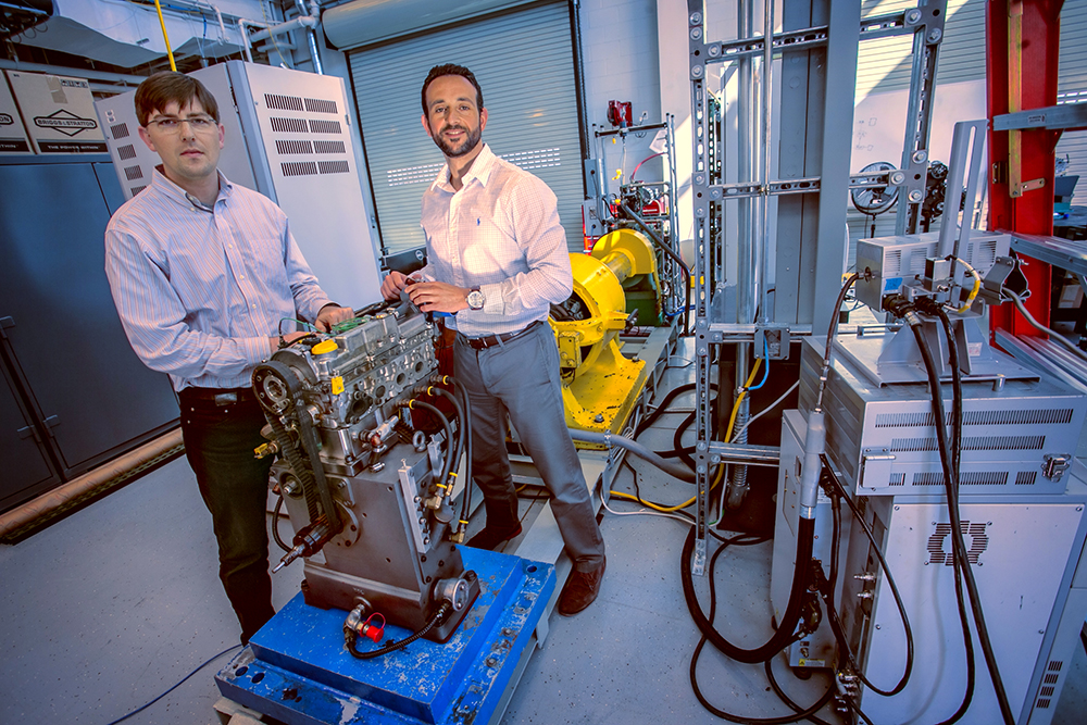 Benjamin Lawler (left) and Sotirios Mamalis (right) work on a proof-of-concept single-fuel RCCI engine at Stony Brook's Advanced Energy Research and Technology Center.