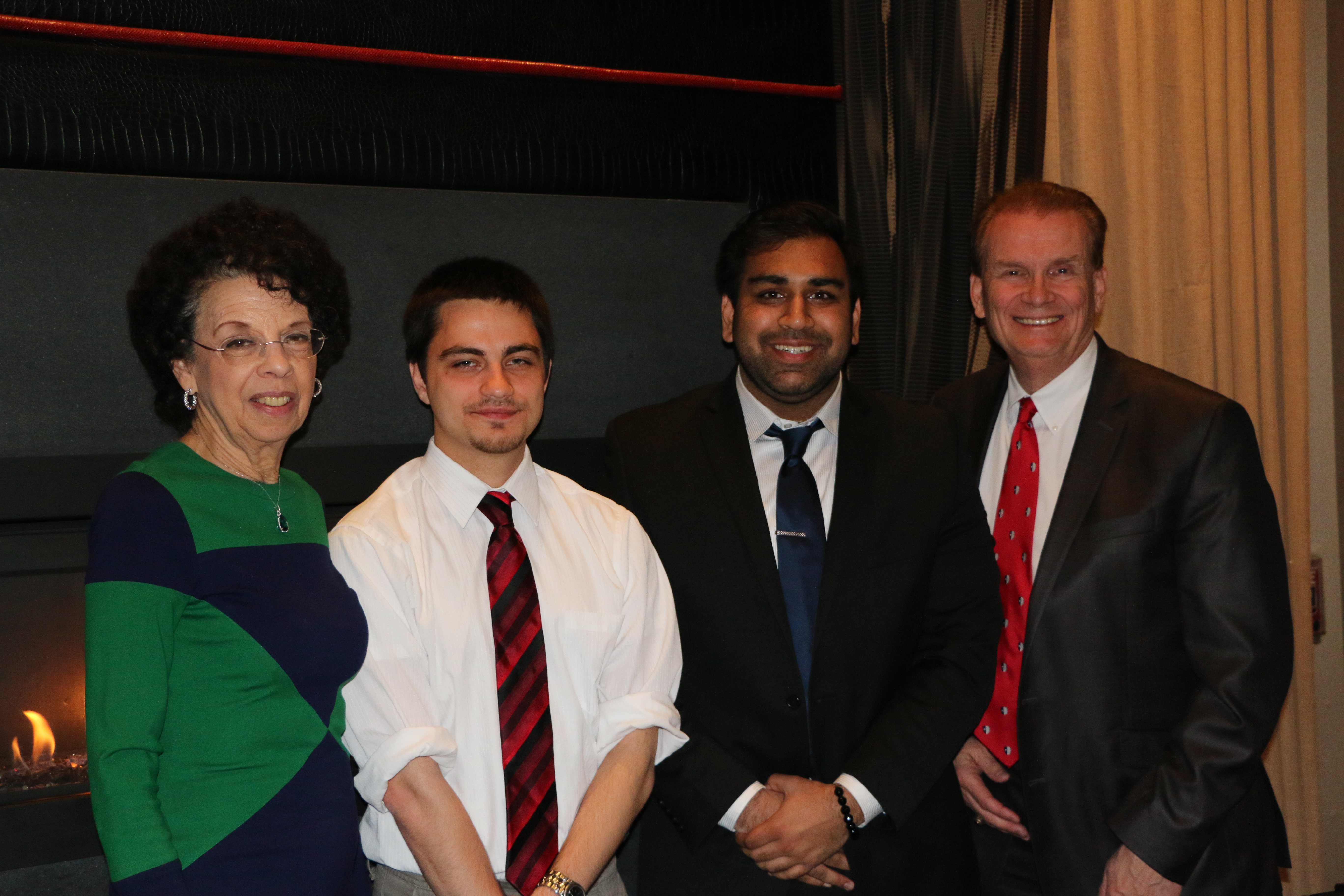 Gregory Poterwicz '16 (center left) and Ravi Patel '16 (center right) pose with Gloria Snyder '72, chair of the Past Presidents Council, and Bob Stafford '72, '82, president of the Stony Brook University Alumni Association, during a dinner reception on April 5 honoring the first three recipients of of the University's Alumni Association Past Presidents Scholarship.