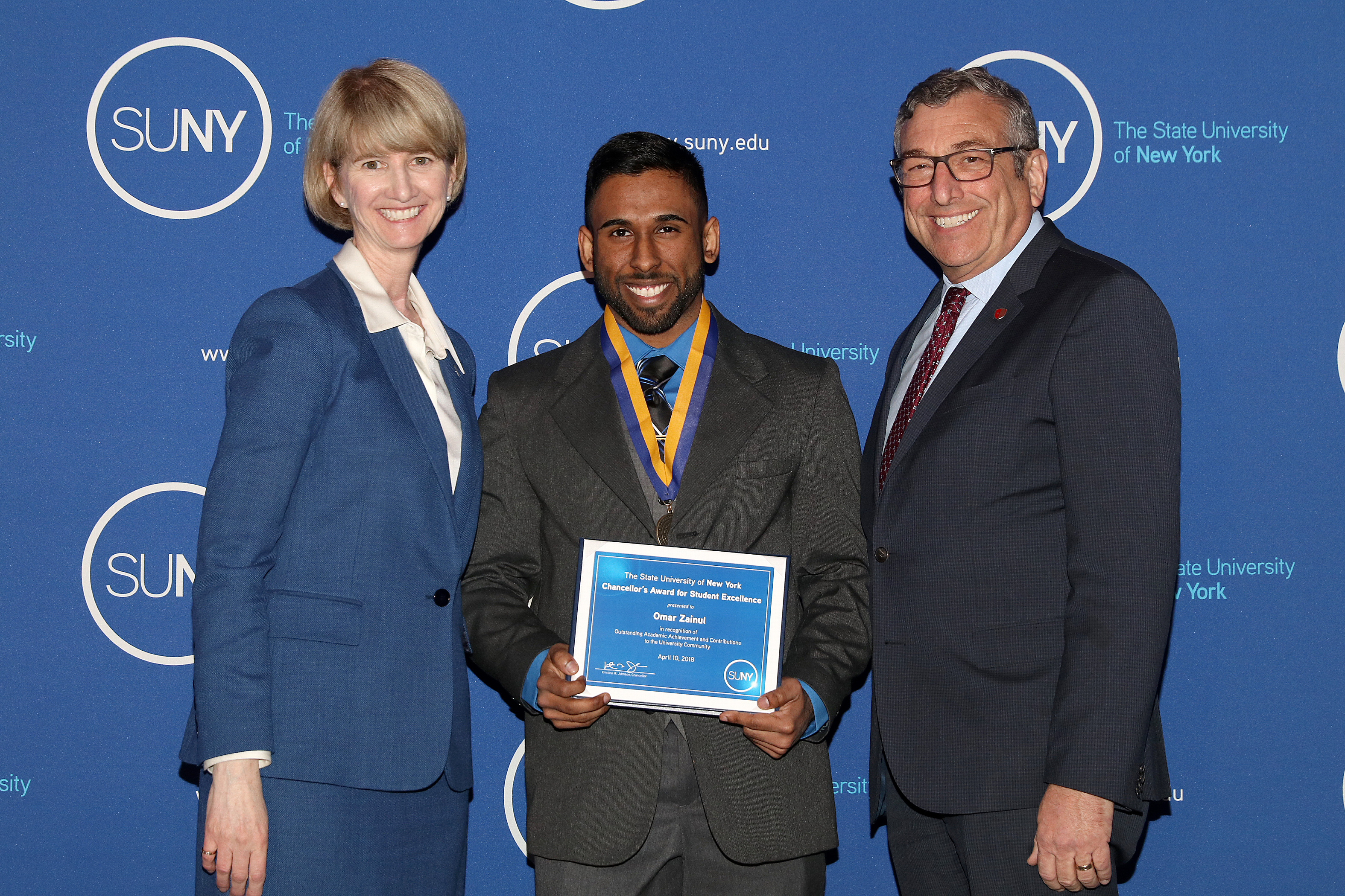 Awardee Omar Zainul with Chancellor Johnson and Vice Provost Robbins