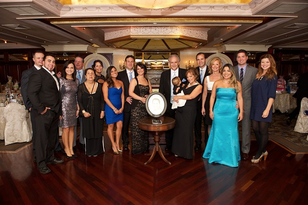 Family and friends of the late Mickey DeMartis raised more than $50,000 for Stony Brook Children's Hospital at an Oct. 6 fundraiser dinner event. The gift will be matched by an anonymous donor for a total impact of more than $100,000. Shown here, left to right, at the event are: John Bruno, Johnny Quigley, Kaylin Quigley, John Quigley, Kay Tromba, Terry Quigley, Laura DeMartis, Bobby Passamenti, Tracey Passamenti, Mike DeMartis, Kathy DeMartis, Michelina Passamenti, Bob Keefe, Joanne Morano, Lola Knight, Steven Willson and Emily Willson.