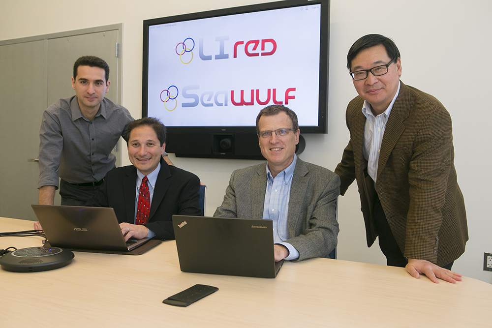 Stony Brook IACS Director Robert Harrison, second from right, leads the SeaWulf computer cluster initiative to further build the University's computational capacity. Also instrumental in the implementation of SeaWulf are, from left: Firat Coskun, a Senior Programmer Analyst for IACS and DoIT; Andrew White, Senior Director, Research Computing, DoIT; and Yuefan Deng, Professor of Applied Mathematics & Statistics.