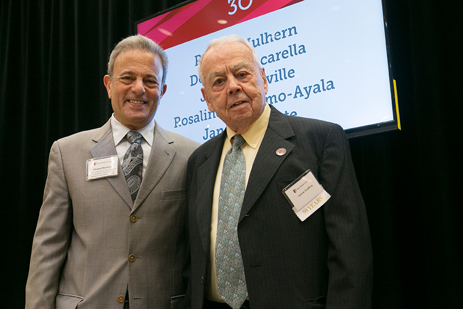 Provost Michael Bernstein and 52-year honoree Bill Godfrey.