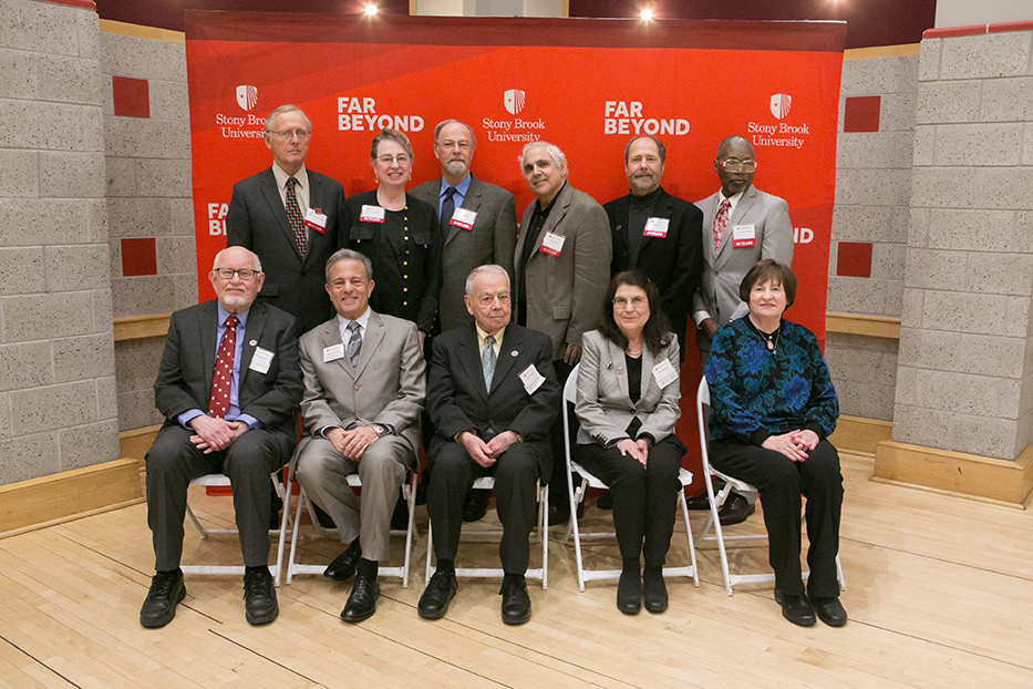 The 40-year and 50-year honorees in attendance with the Provost. Bottom row: Gilbert Hanosn, Provost Bernstein, Bill Godfrey, Mary Bernero and Shirley Romans. Top row: Peter Van Nieuwenhuizen, Toby Buonagurio, Wilbur Miller, Ira Cohen, Dale Deutsch and Gerald Shephard. Rear: Peter van Nieuwenhuizen, Toby Buonagurio, Wiber Miller, Ira Cohen, Dale Deutsch, Gerald Shephard. Front Row: Gilbert Hanson, Michael Bernstein, Aaron Godfery, Mary Berero