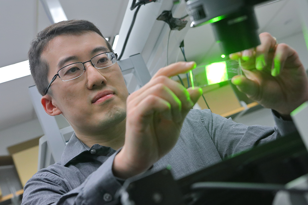 Shu Jia, Assistant Professor of BME works in the wavefront high speed microscopy imaging lab.