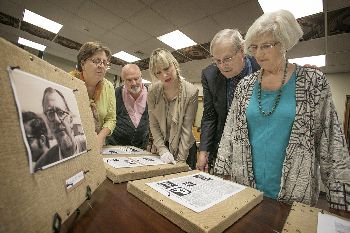 Paul and Martha Siegel stand near a display of their late father Ronald. The Siegel's created the Dorothy J. and Ronald W. Siegel Rare Book Endowment to benefit Stony Brook University Libraries. Pictured L-R: Martha Siegel, Dennis Mynarcik, Kristen Nyitray, Paul Siegel, and Suzanne Siegel