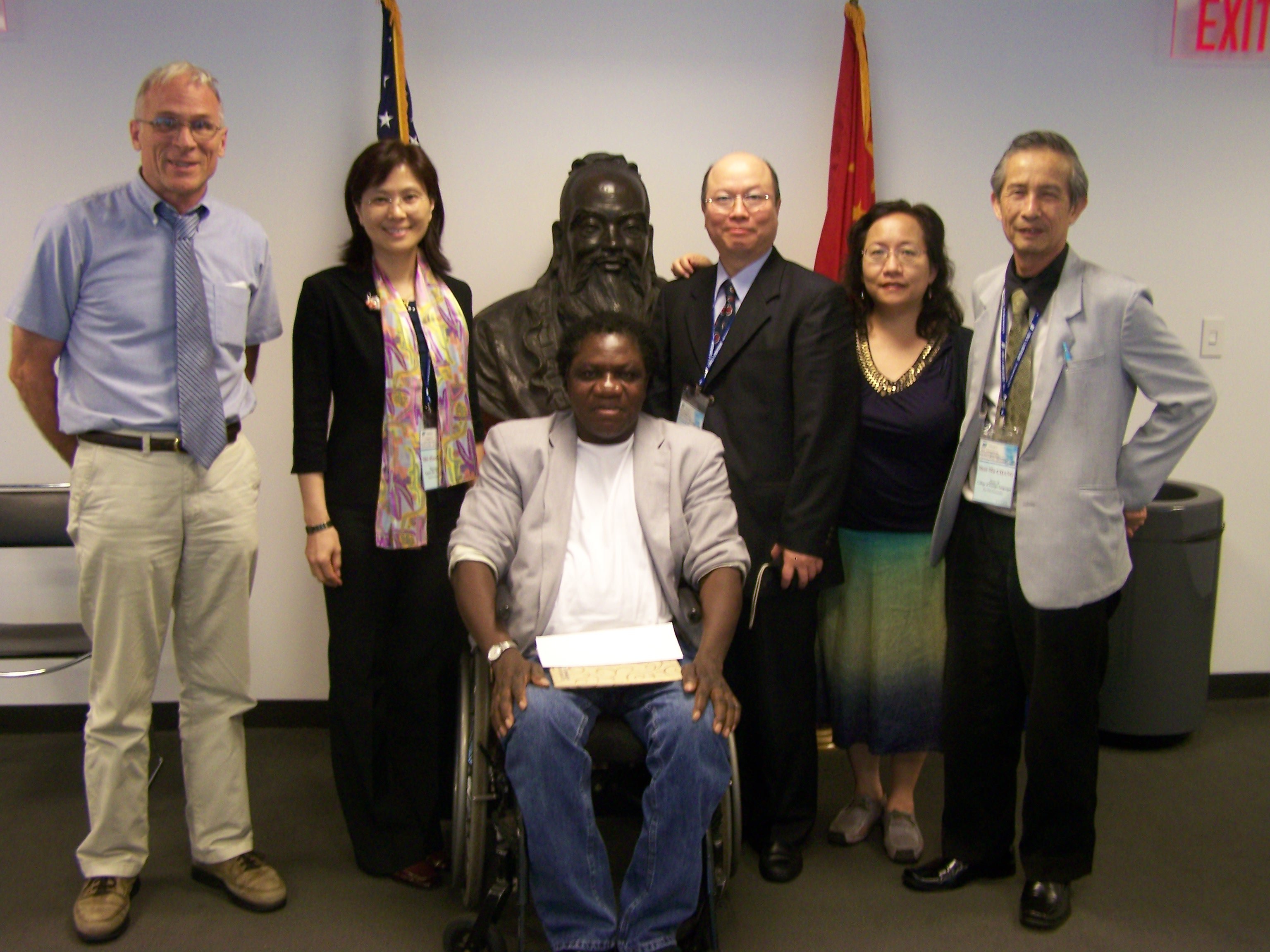Dr. Gene Hammond, Director of the SB Writing and Rhetoric Program (left) and Dr. Prosper Sanou, Professor of French Language and Literature (center) pose with members of the Taiwan Assessment and Evaluation Association in the Wang Center's Confucius Institute on July 15.
