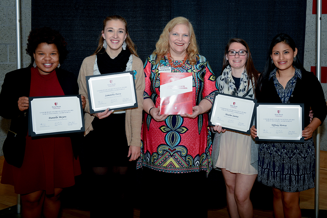 Four graduating seniors from the School of Social Welfare received awards (from left): Danielle Meyers, Samantha Davis, Suzanne Velazquez (Director, Undergraduate Programs, Social Welfare), Heather Savino and Tiffany Hervas.