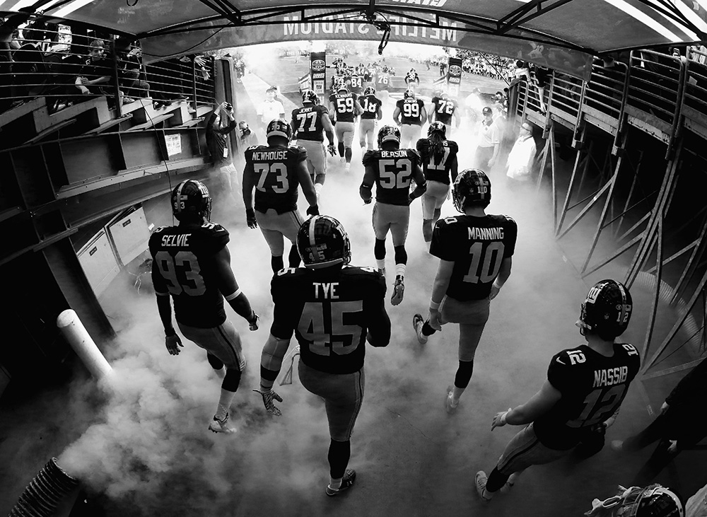 EAST RUTHERFORD, NJ - OCTOBER 25: (Note To Editor: This Digital images has been converted to Black and White) George Selvie #93, Will Tye #45, and Eli Manning #10 and the rest of The New York Giants enter the field against the Dallas Cowboys their game at MetLife Stadium on October 25, 2015 in East Rutherford, New Jersey. (Photo by Al Bello/Getty Images) *** Local Caption *** George Selvie; Will Tye; Eli Manning