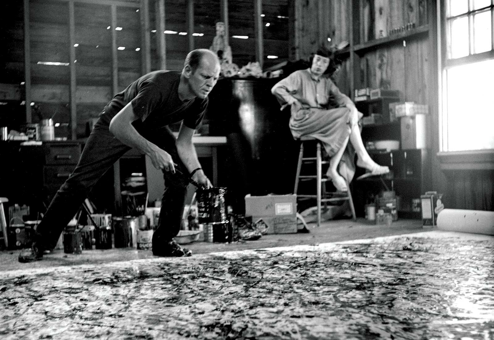 Jackson Pollock painting One: Number 31, 1950, with Lee Krasner observing.