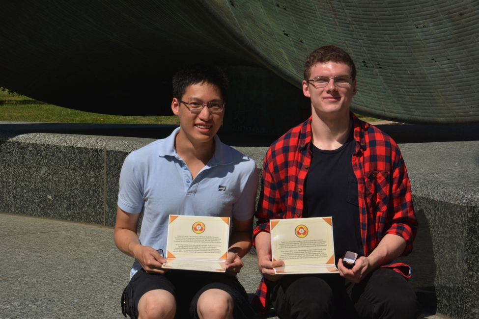 Summer Math Scholarship inaugural recipient Minh Nguyen and second recipient Hubert Puszklewicz holding their certificates and honorary pins from The Summer Math Foundation.