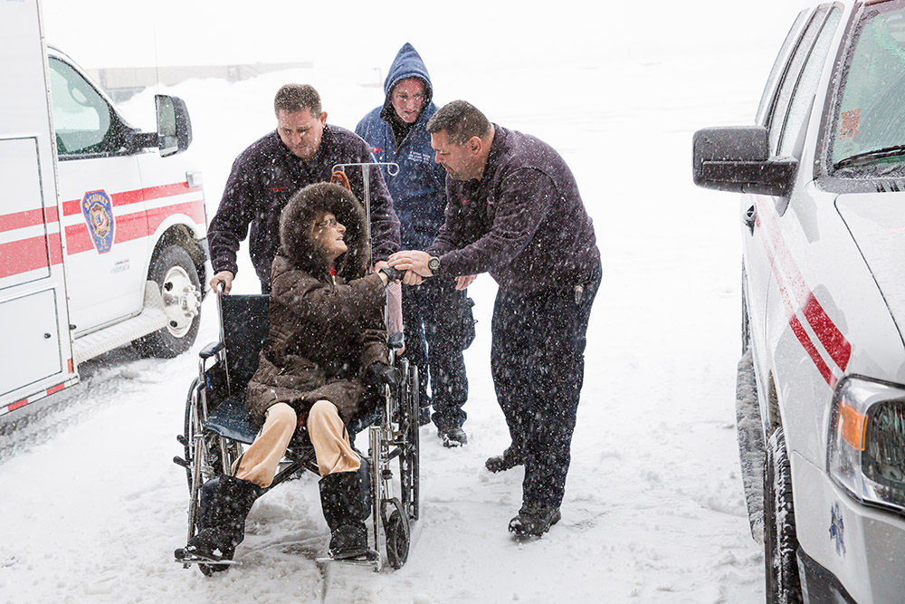 64 year-old, Melanie Chirichella, of Bohemia, thanks Stony Brook Paramedic Pete Amato for getting her to Stony Brook University Hospital for her kidney transplant during the 2016 blizzard. Amato's brother, Greg, who is also a kidney transplant recipient, wheeled Chirichella into the hospital while it snowed. (Photo Credit: Michael James Beck, MD)