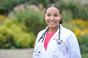 Leslie Peralta dons her medical student white coat and first stethoscope.