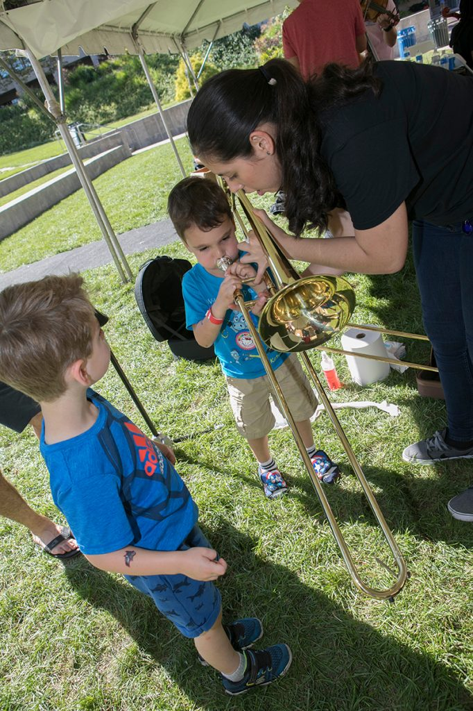 "Children learn about musical instruments in the ""Petting Zoo."""