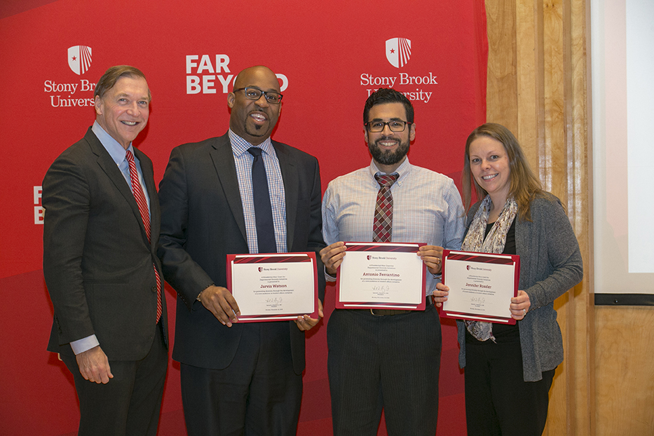 Jarvis Watson (second from left), Antonio Ferrantino (second from right) and Jennifer Rossler (far right) were recognized for their work in creating diversity and inclusion professional development opportunities for student affairs professionals and graduate students.